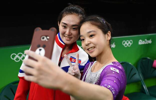 Hong Un-Jong from the DPR Korea and Lee Eun-Ju from south Korea taking selfie together.