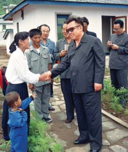 Kim Jong Il visits a farmer's family of the Poman Cooperative Farm in Sohung County, July 2001