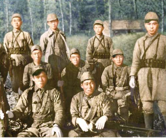 Kim Il Sung among the soldiers of the Korean People's Revolutionary Army (standing in the middle of the back row).