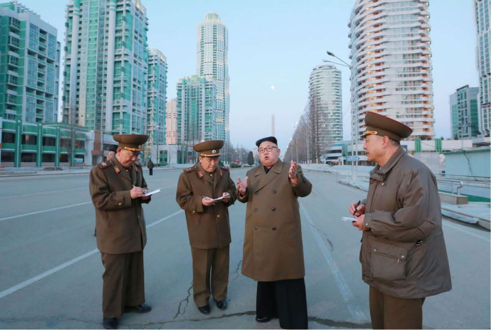 The respected Supreme Leader Kim Jong Un inspects the construction site of the Ryomyong Street [March Juche 106 (2017)].