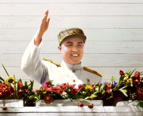 Kim Il Sung acknowledges enthusiastic cheers of officers and men of the heroic Korean People's Army and the people.