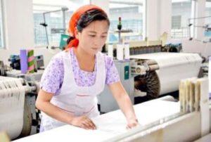 Han Myong Hui, a weaver.