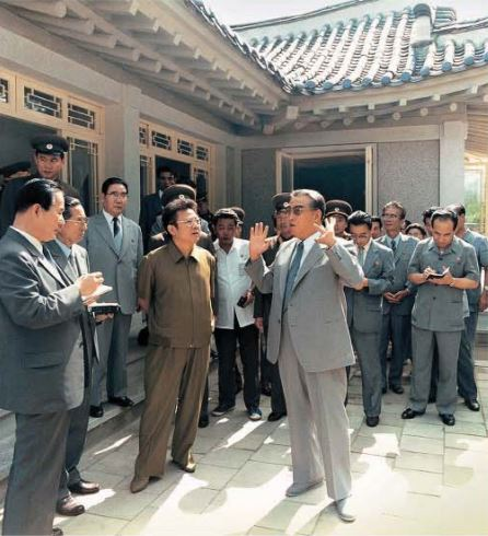 President Kim Il Sung and Chairman Kim Jong Il look round the Korean-style dwelling houses newly built at Nam-ri village, Mangyongdae [August Juche 74 (1985)]