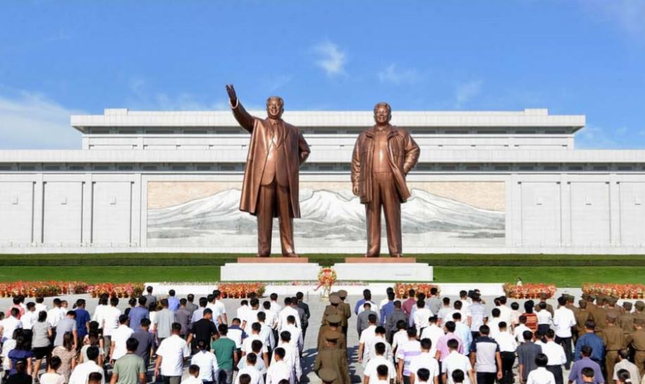 Service personnel, working people of all strata, young people and schoolchildren visit the statues of President Kim Il Sung and Chairman Kim Jong Il.