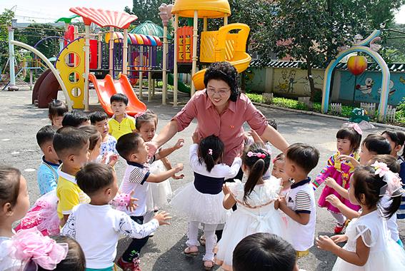 Kim tends her nursery children like their mother