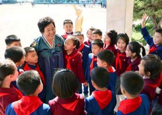 Headmistress Kim Myong Sun, People's  Teacher, is held in respect.