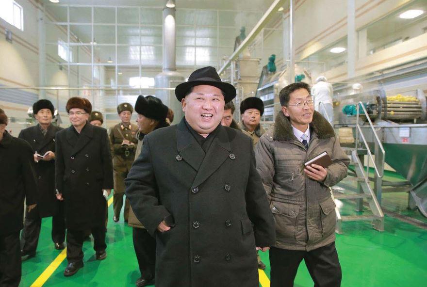 The respected Supreme Leader Kim Jong Un looking round the newly-built Samjiyon Potato Farina Factory [December Juche 106 (2017)]