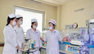 Ryu Su Ok ( fi rst right) is engrossed in the training of nurses.